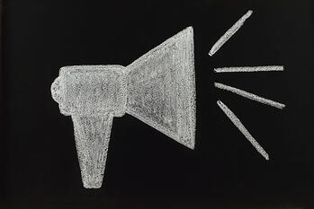 How to Get Your Business Name Out There - Chalk Drawing of a Loud Speaker