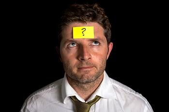 Image of a man with a sticky note on his forehead