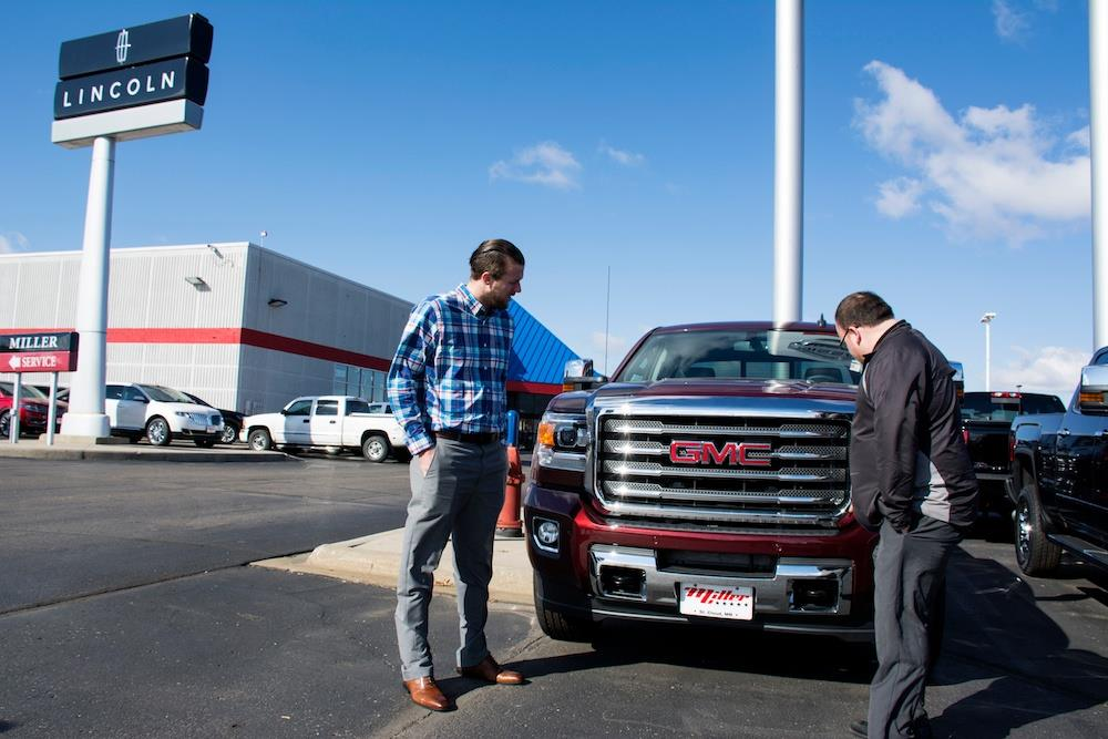 Miller Auto & Marine, Showing a GMC Truck to a Potential Buyer