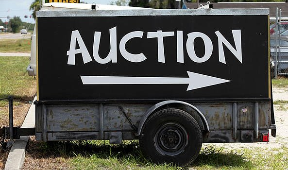 What are Radio Auction Sites? | Trailer with Auction Sign and Arrow