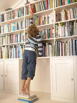 What Exactly is Radio Reach and Frequency? | Young Boy Reaching for a Book on Shelf