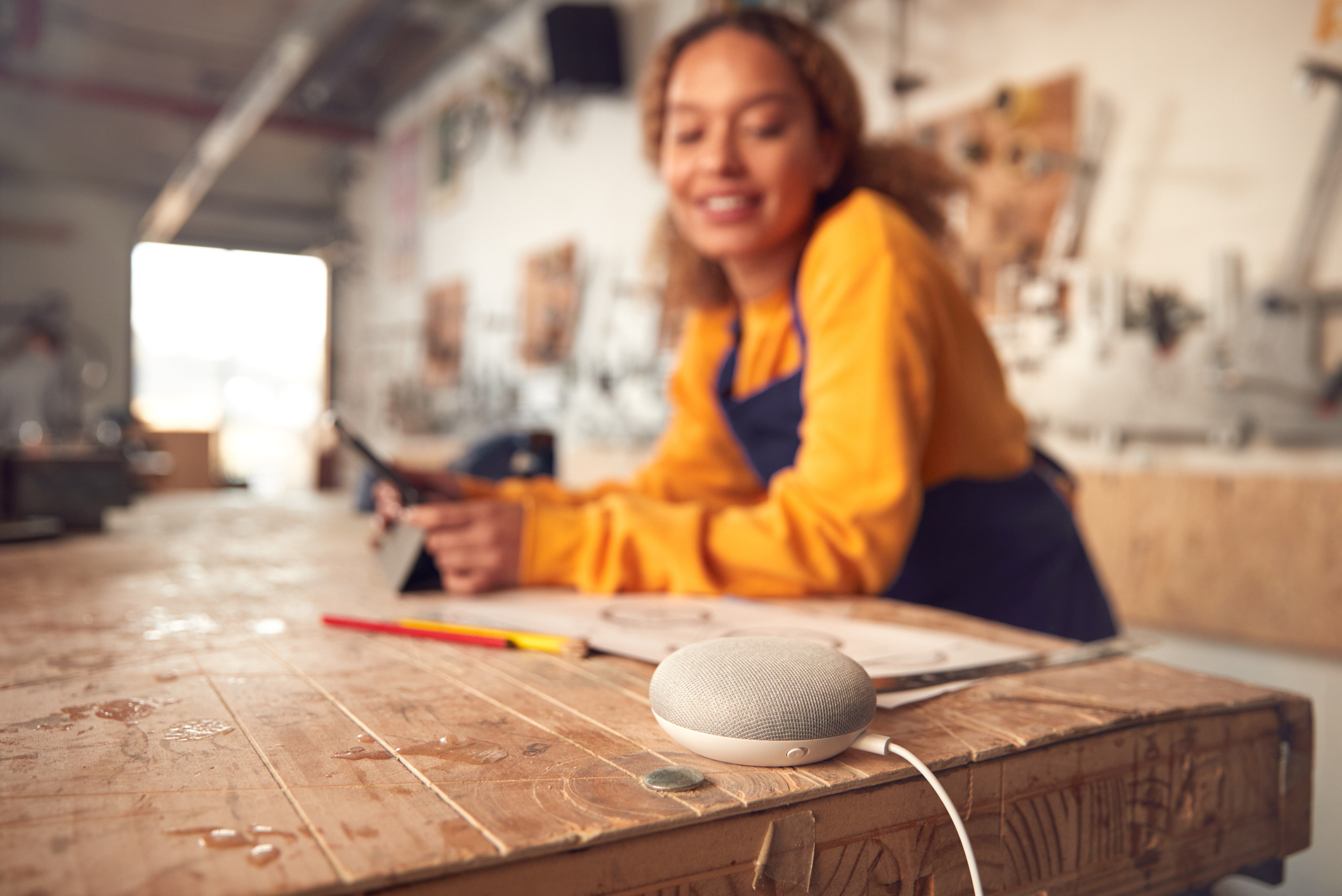 Woman working and using smart speaker